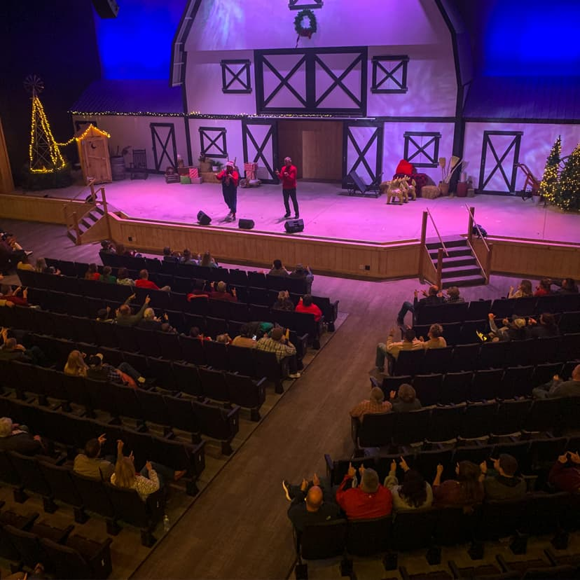lighted stage with Christmas decorations and performers
