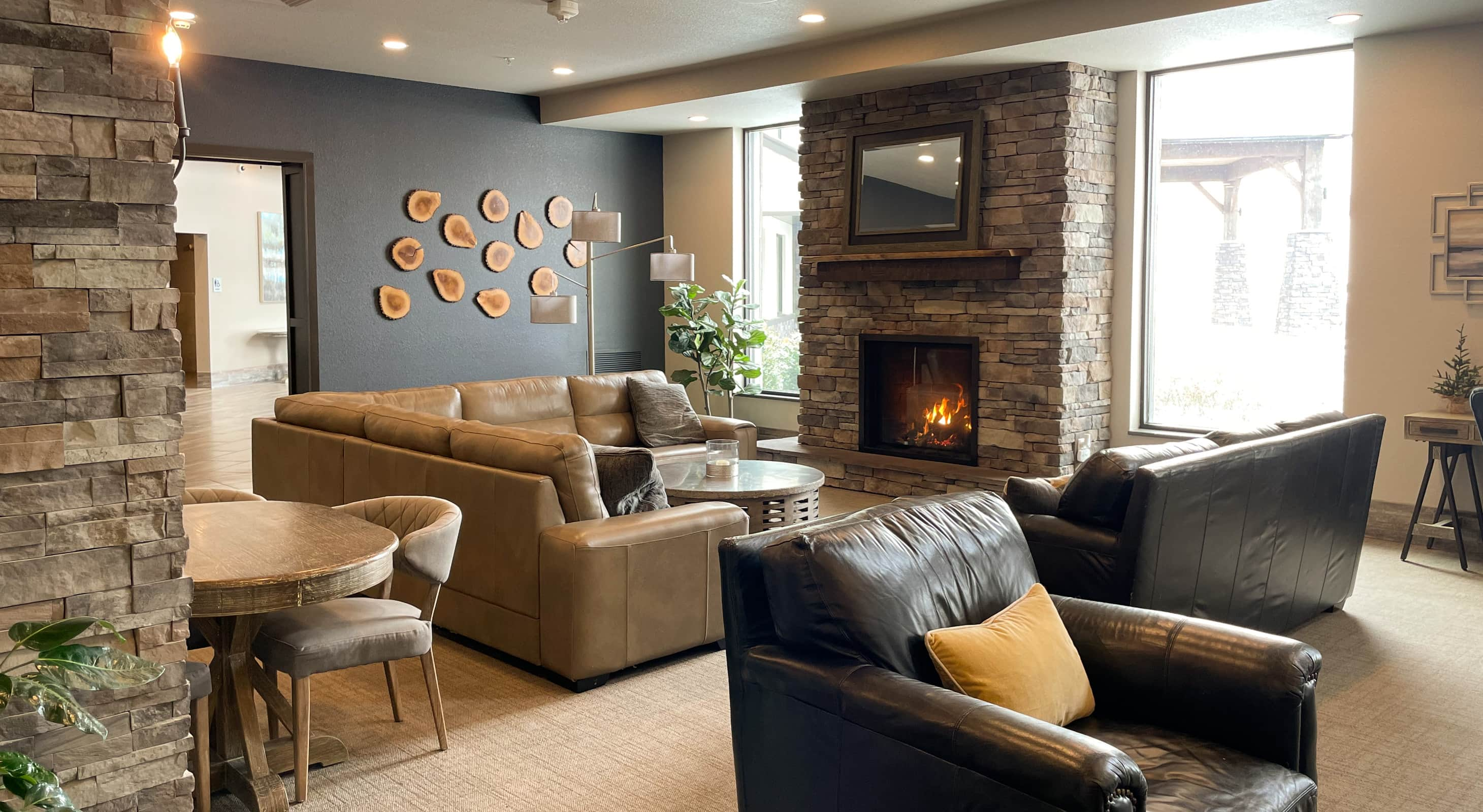 Spacious seating area with a fireplace at the Berlin Encore Hotel