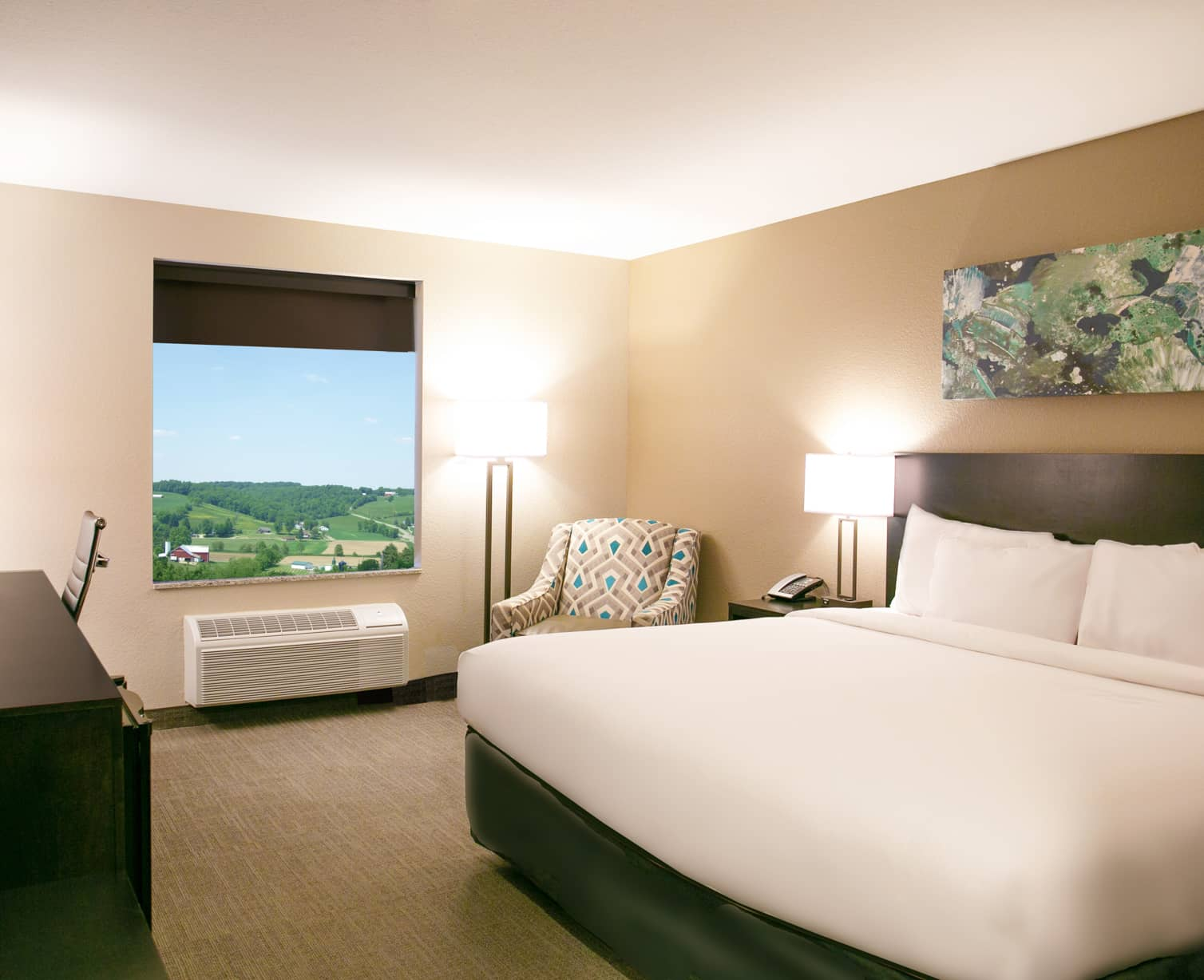 King bed in the deluxe Berlin Encore Hotel with a view of the Ohio countryside