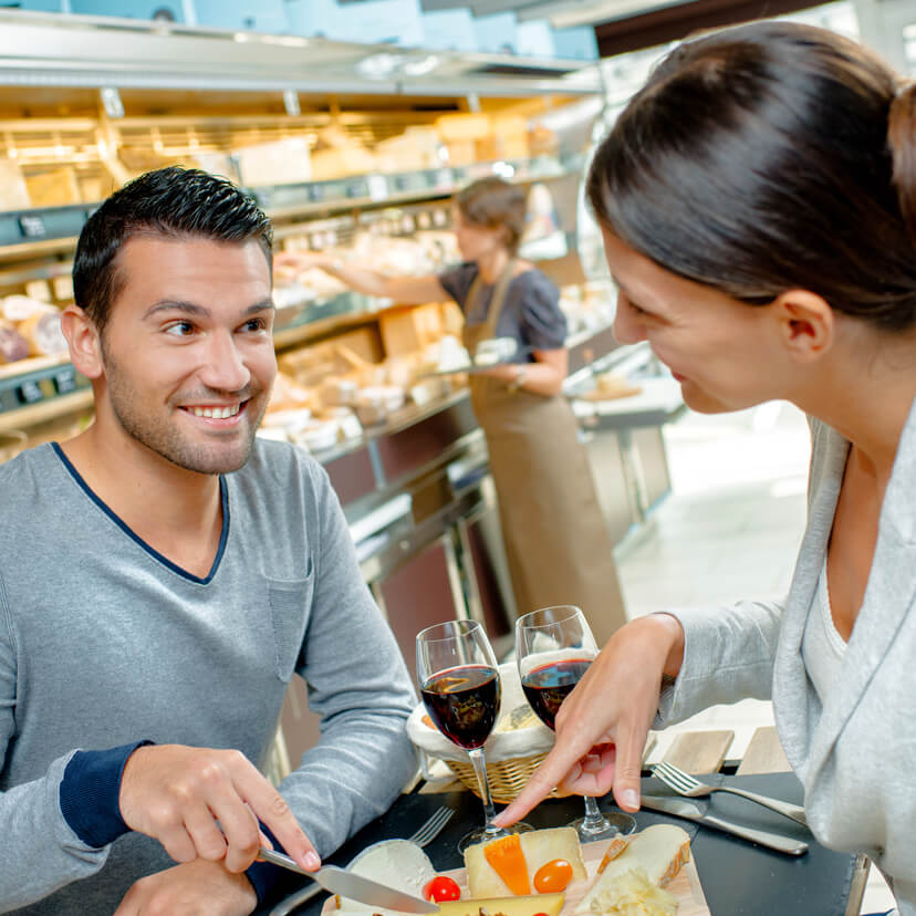 couple in gourmet shop tasting wine and cheese in Amish Country