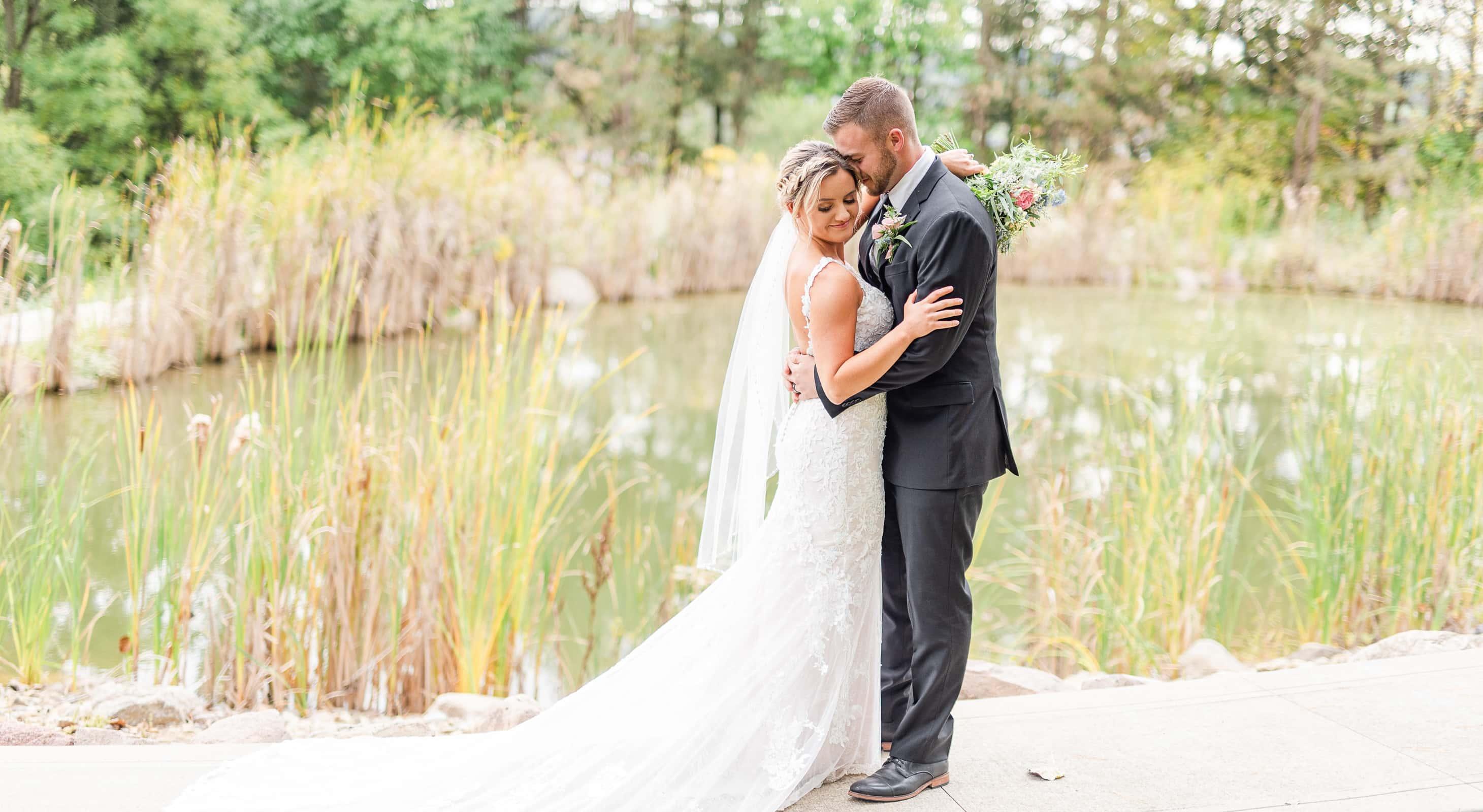 Bride & Groom near a small pond